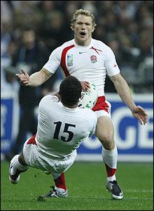Josh Lewsey (top) watches on as Jason Robinson gathers a high ball