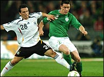 Steve Finnan (right) challenges Piotr Trochowski at Croke Park