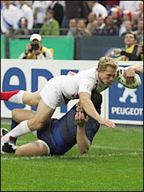 Josh Lewsey blasts through Damien Traille to open the scoring for England