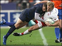 France winger Vincent Clerc tackles Josh Lewsey into touch