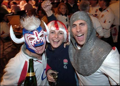 Three England fans in costume