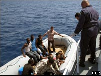 African immigrants are intercepted by Italian coastguards