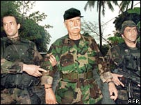 Bob Denard (centre) surrenders to French troops in the Comoros in 1995