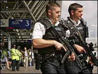 Two armed British police officers