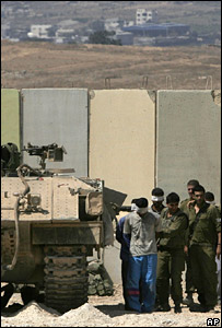 Israeli soldiers escort blindfolded and handcuffed Palestinians captured during an Israeli raid in Gaza (15 September 2007)