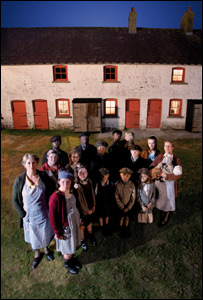 The families outside the miners' cottages in Blaenavon