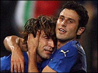 Andrea Pirlo and Fabio Grosso celebrate against Georgia