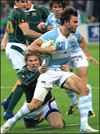 Pumas fly-half Juan Martin Hernandez is tackled by Francois Steyn