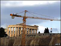 A metal box containing a part of the frieze of the northern end of the Parthenon, is moved by cranes from the Acropolis