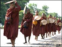 Monks beg for alms near Rangoon, Burma, on 12 October 2007