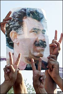 Turkish Kurds hold posters of Abdullah Ocalan. File photo