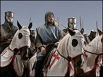 Men on horseback dressed as Crusaders