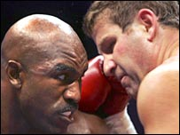 Holyfield (left) clashes with Ibragimov