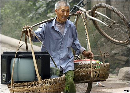 Chinese man carries bicycle