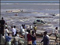 People on the shore at Madras survey the debris in the aftermath of the 2004 tsunami