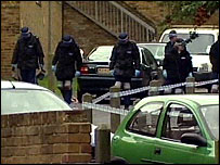 Police search the scene in Plumstead