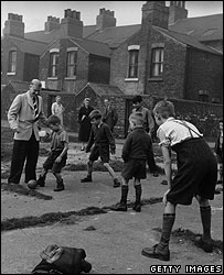 Footballer Wilf Mannion plays with kids in 1951