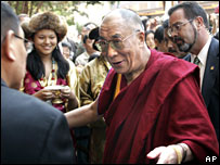 The Dalai Lama is greeted on arrival in Washington