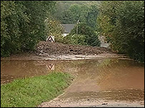 Mudslide after part of the canal burst its banks