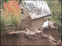 Landslide after part of the canal burst its bank