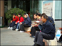 Patients wait outside Wuhan's Tong Ji hospital
