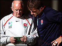 England coach Brian Ashton (left) talks with Mark Cueto during training on Tuesday
