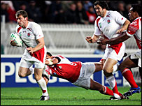England's Mark Cueto (left) playing against Tonga