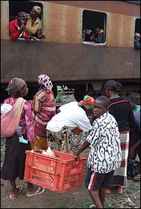 Mozambicans selling food at a railway station
