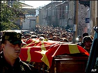 Soldiers bearing the coffin of Tose Proeski
