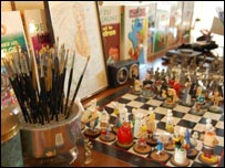 Paint brushes and an Asterix chess set