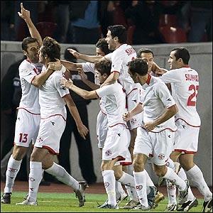 The Georgian players celebrate
