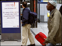 A man looks at a board at Saint-Lazare station in Paris announcing the cancellation of trains for the 24-hour strike 17 October, 2007