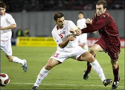 James McFadden and Zurab Khizanishvili clash in  the box
