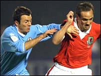 San Marino's midfielder Damiano Vannucci challenges Wales' midfielder David Vaughan 