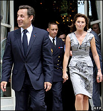 Mr Sarkozy and his wife at a garden party at the Elysee in Paris