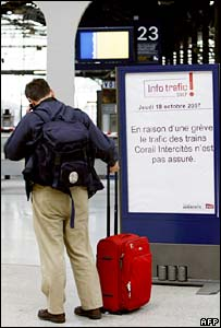 A man looks at a board at Saint-Lazare station in Paris announcing the cancellation of trains for the 24-hour strike
