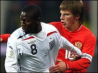 England's Shaun Wright-Phillips (left) with Russia's Andrey Arshavin