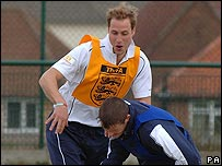 Prince William playing football at West Gate Community College