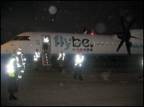 Passengers disembarking from the flight in Exeter