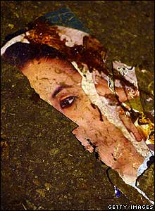 A torn poster of Benazir Bhutto