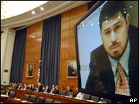 Maher Arar appears on a video screen before a House hearing