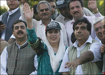 Miss Bhutto waving to supporters before the blast