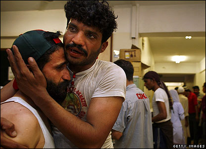 Bomb victims comfort each other in hospital