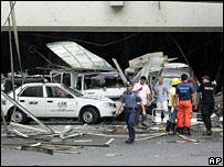 Damaged cars outside the Gloria shopping mall in Manila