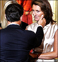 Nicolas Sarkozy reaches out to his wife, Cecilia, after his swearing-in ceremony