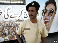 A Pakistani soldier stands in front of Benazir Bhutto's bus after a suicide attack in Karachi
