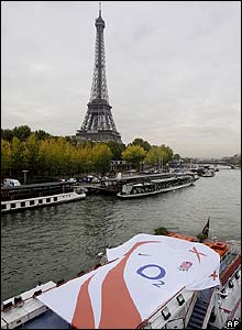 A giant England rugby shirt is transported along the River Seine
