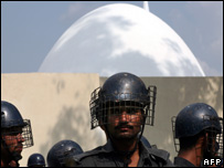 Pakistani policemen stand guard in front of the Red Mosque in Islamabad (file photo)