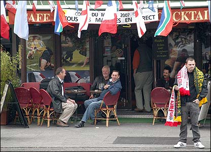 A man sells England and South Africa merchandise in Paris