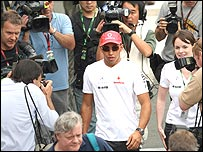 Lewis Hamilton surrounded by photographers in Brazil